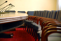 Microphones in empty conference hall. Businnes meeting Royalty Free Stock Image