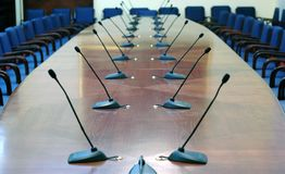 Microphones in empty conference hall. Concept of business meeting Royalty Free Stock Photo