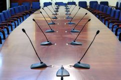 Microphones in empty conference room. Microphones in empty conference hall businnes meeting concept Stock Images