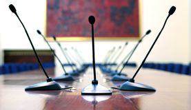 Microphones in empty conference room. Microphones in empty conference hall businnes meeting concept Stock Photography