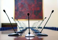Microphones in the empty conference room. Business meeting concept empty conference room Royalty Free Stock Photo