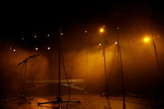 Microphones in an empty rock concert stage Royalty Free Stock Photography