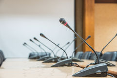 Microphones in front of empty chairs. Stock Photography