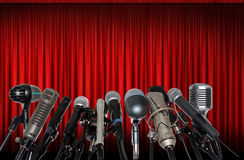 Microphones in Front of Red Curtain Stock Photography