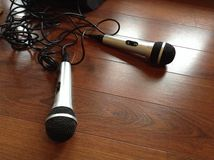 Microphones. Karaoke's over guys Royalty Free Stock Images