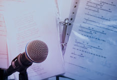 Microphones on lyric background. Stock Photos