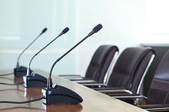 Microphones in the meeting room. Conference microphones in a meeting room Stock Photos