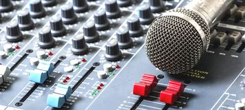 Microphones and mixers on the table.  royalty free stock images