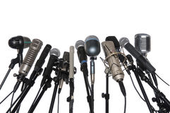 Microphones Over White Background. Microphones of various styles isolated over white background Royalty Free Stock Photo