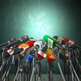 Microphones prepared for press conference or interview on green Royalty Free Stock Photography