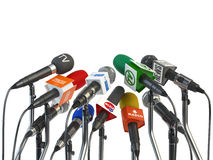 Microphones prepared for press conference or interview isolated Stock Image