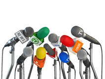 Microphones prepared for press conference or interview isolated Stock Photos