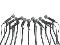 Microphones prepared for press conference or interview isolated Royalty Free Stock Images
