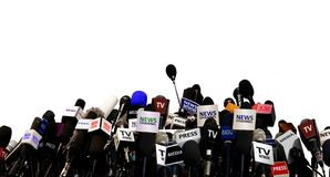 Microphones during press conference. Over white Stock Images