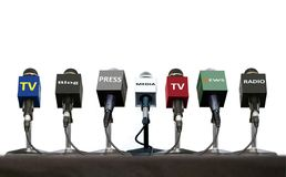 Microphones during press interview on a table over white. Press interview microphones on a table over white royalty free stock photo