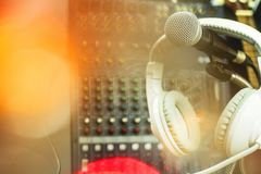 Microphones and recording equipment in the studio. Microphone with professional audio mixer in the control room stock photo