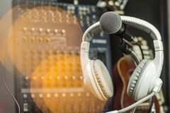 Microphones and recording equipment in the studio. Microphone with professional audio mixer in the control room stock photos