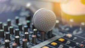 Microphones and recording equipment in the studio. Microphone with professional audio mixer in the control room royalty free stock image