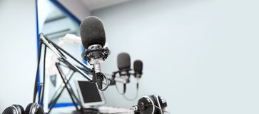 Microphones at recording studio or radio station. Technology and audio equipment concept - microphones at recording studio or radio station stock photography