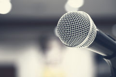 Microphones singing on stage in black colour. In film tone Stock Image