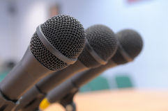 Microphones stand at conference hall. Royalty Free Stock Photos