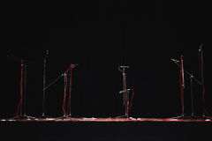Microphones on Stands and Red Cords Royalty Free Stock Photo