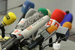 Microphones on a table. KYIV, UKRAINE - DECEMBER 8: Microphones on a table during press-conference before UEFA Champions League football match between Dynamo Royalty Free Stock Photo