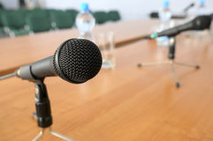 Microphones on tripod stands on a table. Microphones on tripod stands on a table in a room Stock Photography