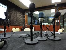 Microphones and voice. Voice and audio recording studio with four microphones and a set of headphones stock images