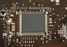 Microplaqueta do portátil no close up da placa de mãe Fotografia de Stock