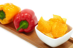 Microplaquetas da paprika com pimentas Fotos de Stock Royalty Free