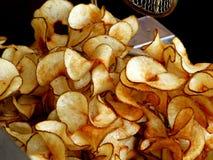 Microplaquetas de batata da chaleira Imagem de Stock