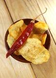 Microplaquetas de batata picantes Imagens de Stock Royalty Free