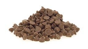Microplaquetas de chocolate pequenas do leite da pilha Imagens de Stock