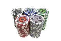 Microplaquetas de pôquer empilhadas isoladas no fundo branco Fotos de Stock Royalty Free