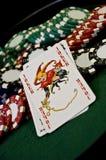 Microplaquetas do cartão e de póquer do palhaço Imagem de Stock