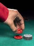 Microplaquetas e mão Foto de Stock Royalty Free