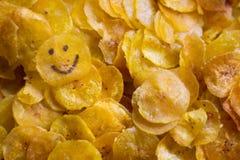 Microplaquetas felizes do banana-da-terra imagem de stock
