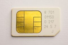 Microprocesador de Sim Card Mobile Cellular Phone en el fondo blanco Fotografía de archivo