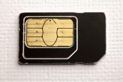 Microprocesador de Sim Card Mobile Cellular Phone en el fondo blanco Imágenes de archivo libres de regalías