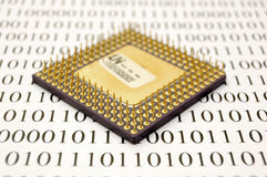 Microprocessor and binary code. Conceptual photo. Shallow depth of field Royalty Free Stock Photography