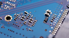 Microprocessor on blue circuit board Royalty Free Stock Image