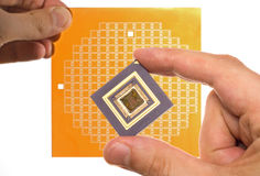 Microprocessor and chip mask in hand Stock Photography