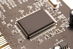 Microprocessor on the circuit board Royalty Free Stock Photos