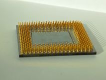 Processor Gold Contacts. Microprocessor gold contacts on the paper Stock Image