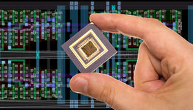 Microprocessor in hand and chip layout Stock Photos
