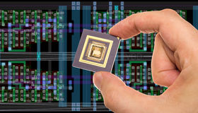 Microprocessor in hand and chip layout Royalty Free Stock Photos