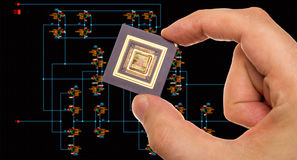 Microprocessor in hand and circuit schematic Stock Photos