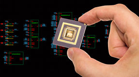 Microprocessor in hand and circuit schematic Royalty Free Stock Image