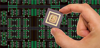 Microprocessor in hand and its layout Royalty Free Stock Photo